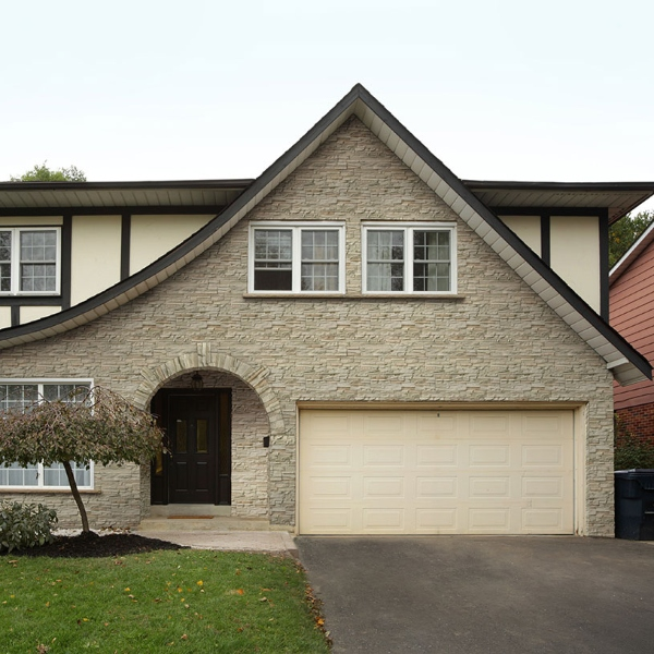 stacked stone house with curb appeal