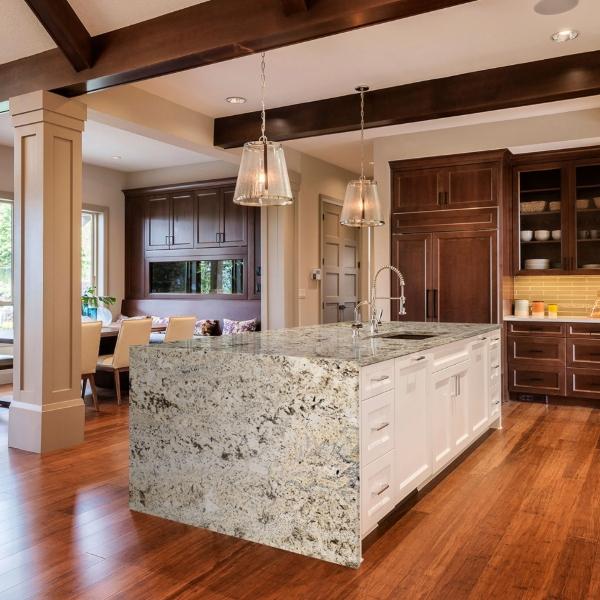 waterfall granite counter in wood floor kitchen