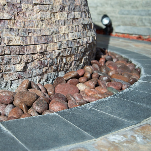 edge covering with pebbles for hardscape garden