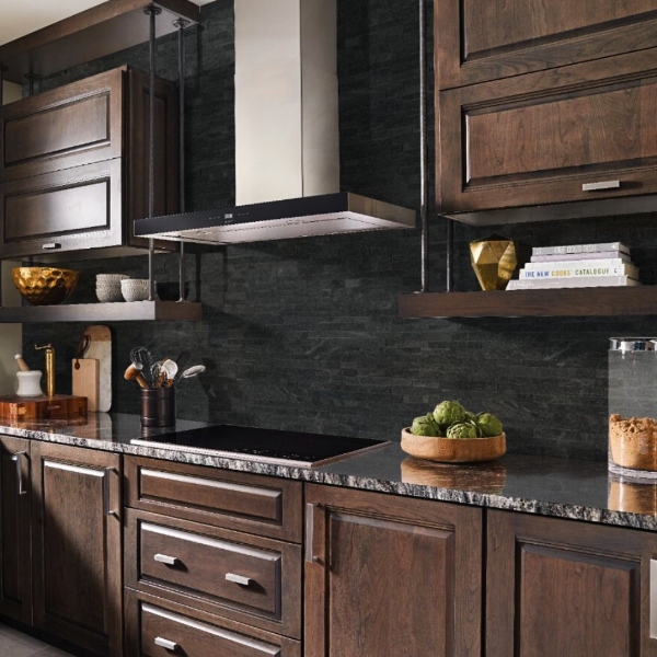 dark granite with rich brown cabinets and black tile