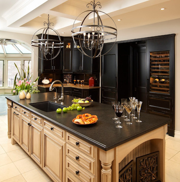 honed granite counter with blonde cabinets