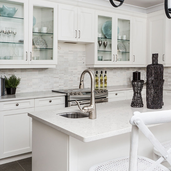 brilliant white marble look quartz in kitchen with glass door cabinets