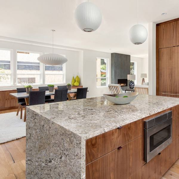 waterfall edge granite in all stained wood kitchen