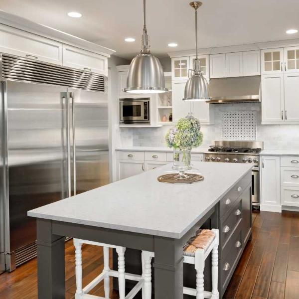 quartz kitchen with steel fridge