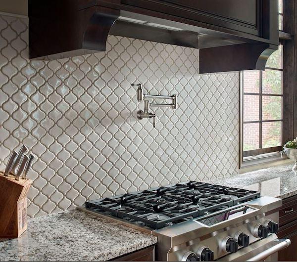 arabesque tile backsplash with water spout