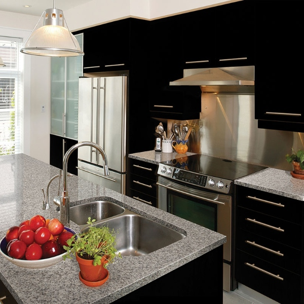 granite kitchen counter with black cabinets