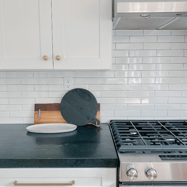 black granite counter in white kitchen