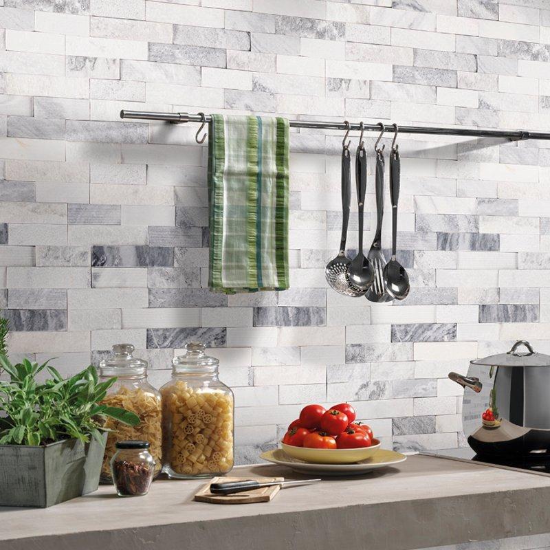 multifinish stacked stone kitchen backsplash