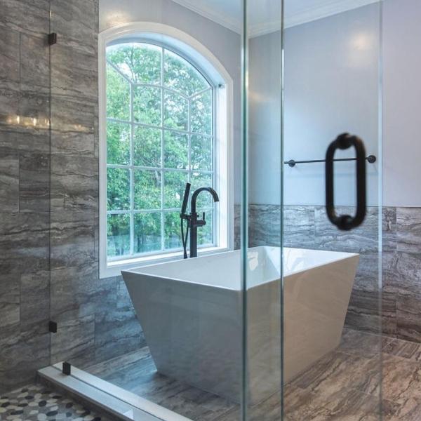 warm porcelain stone look tile surrounding bathtub