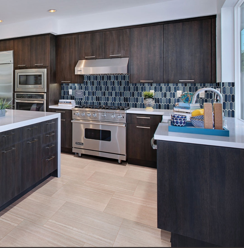 dark and white kitchen with blue tile backsplash