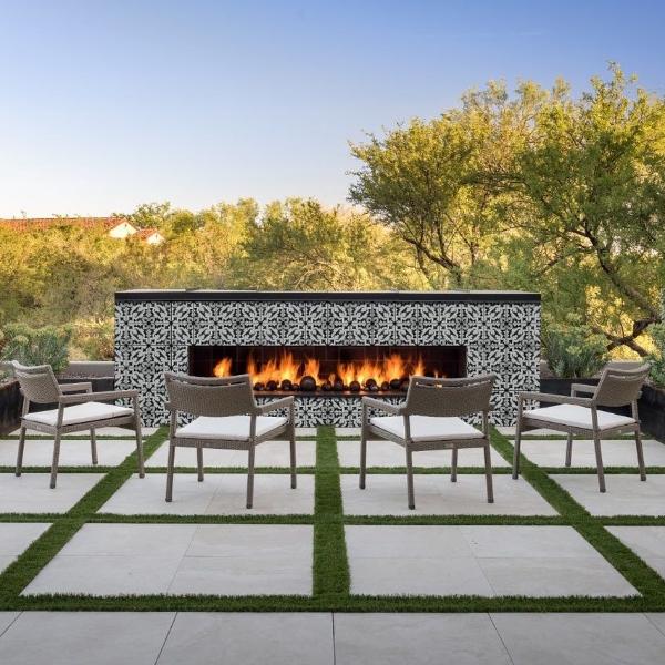 outdoor porcelain tile fireplace in modern floral pattern
