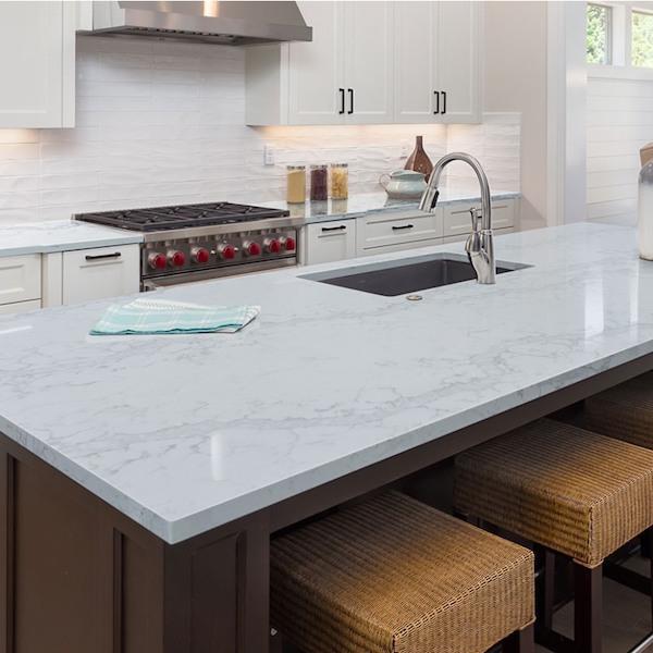 marble look quartz on dark wood island