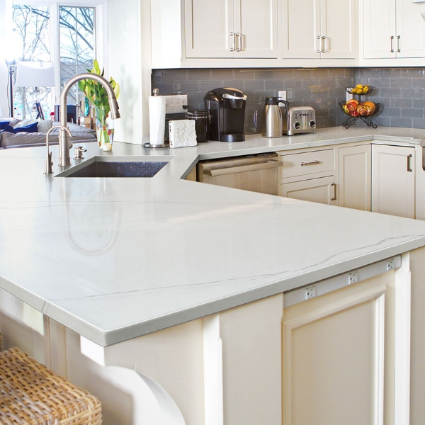 bright white marble look quartz kitchen bar counter with white cabinets