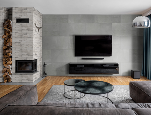 white and gray living room with stackes stone modern fireplace