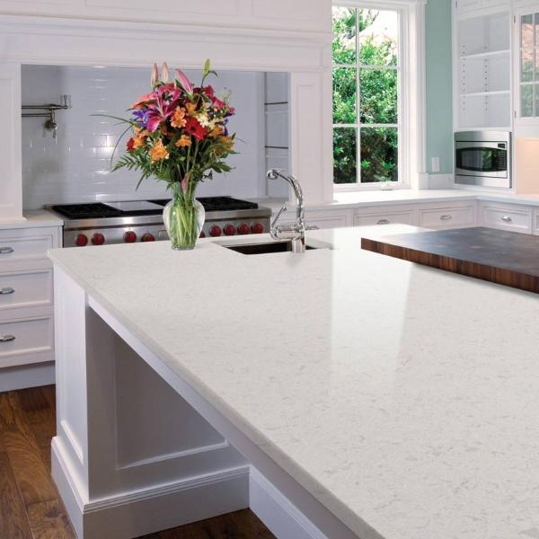 bright white quartz kitchen with large island