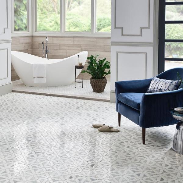 wood look marble tile surrounding modern tub