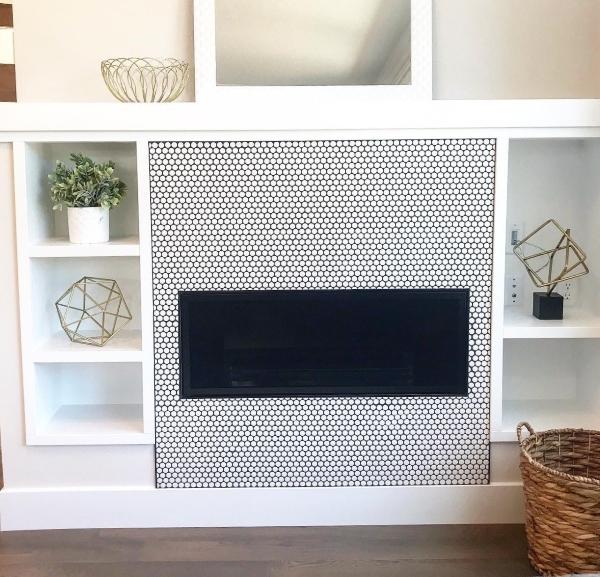 white penny porcelain mosaic tile fireplace