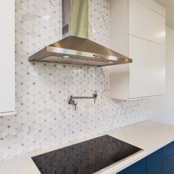 traditional marble mosaic backsplash in cream and white