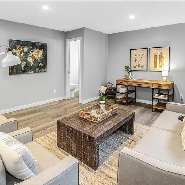 stylish light wood look vinyl tile in gray living room
