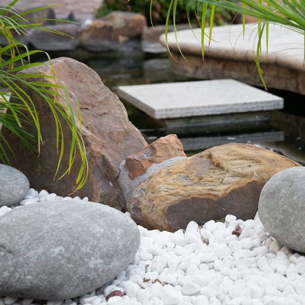 drought tolerant landscapingwith pebbles and more