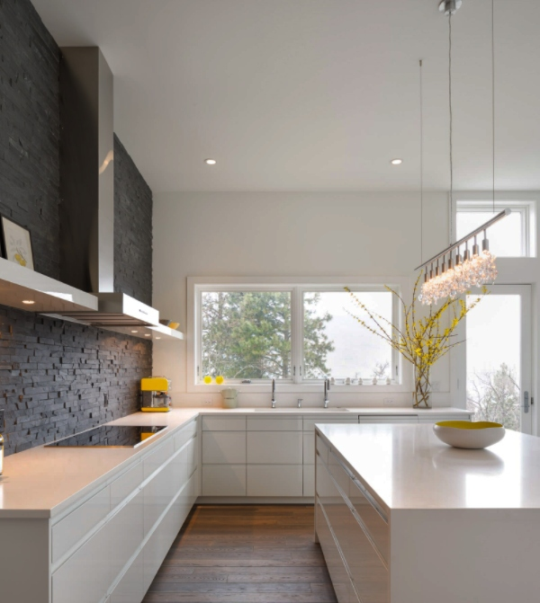 featured stacked stone wall in white modern kitchen