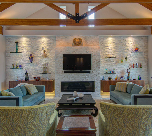 limestone feature wall and fireplace in modern retro living room