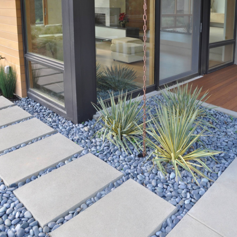 soft gray pebbles with modern stepping tiles