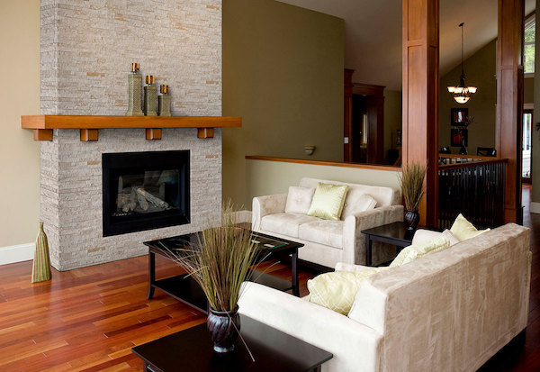 stacked stone panel fireplace with wood floors