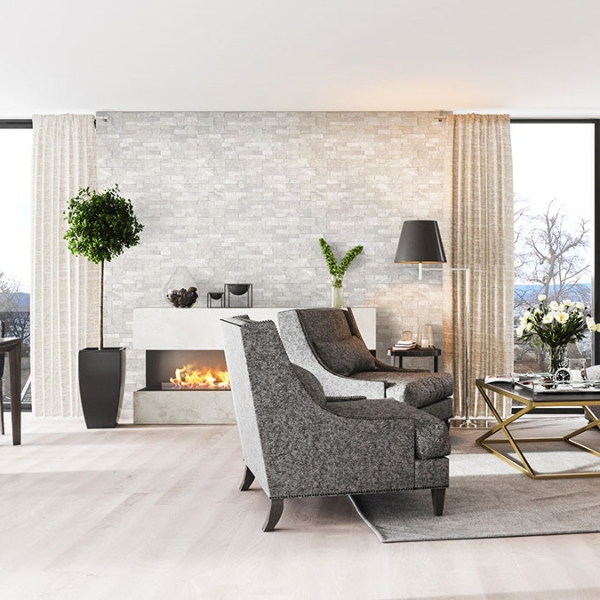 white and silver stacked stone fireplace in loft