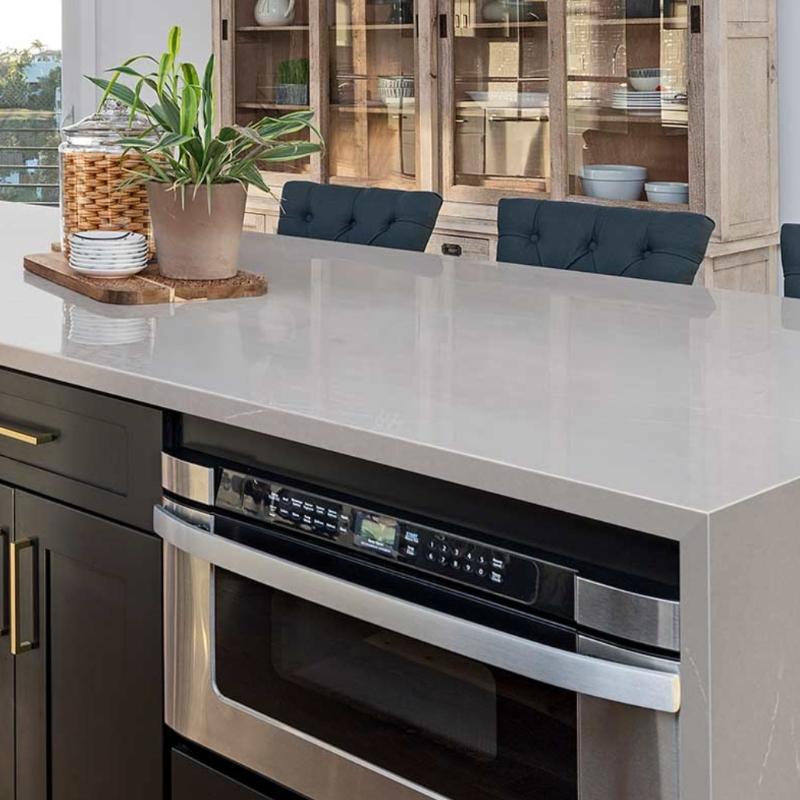 smokey quartz island in gourmet kitchen