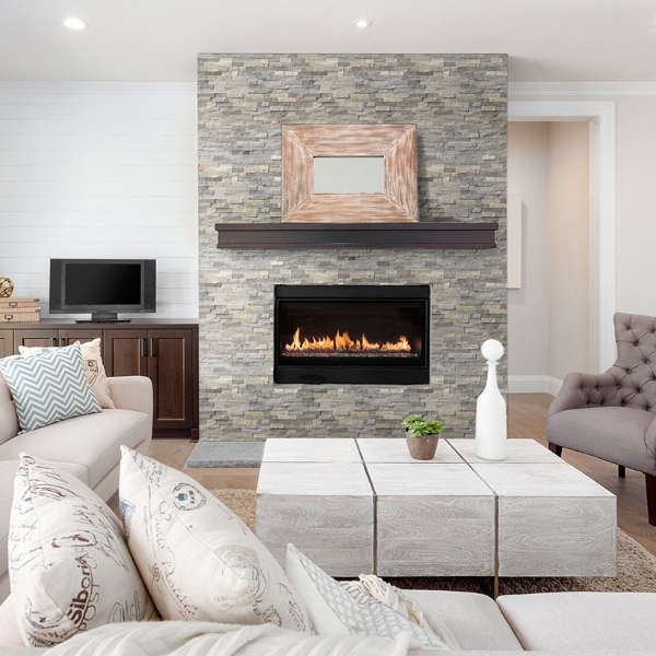 stone fireplace in white and light blue living room
