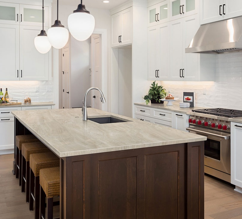 polished quartzite look porcelain counter in bright kitchen