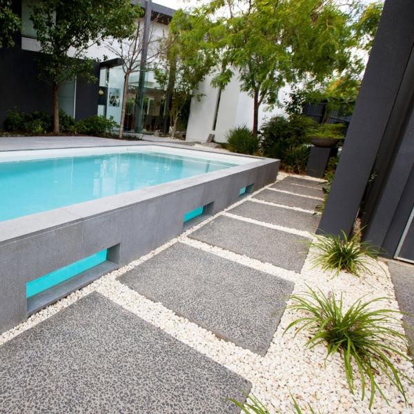 hardscape surrounding elevated pool