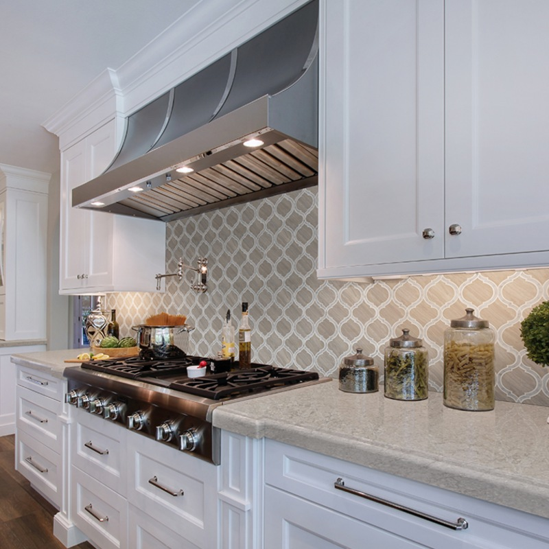 high end kitchen with marble backsplash