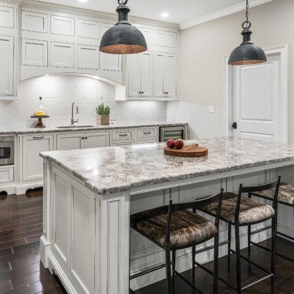 all white kitchen with cream variation granite