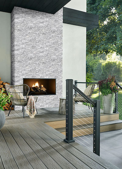 stacked stone wall fireplace in lounge area