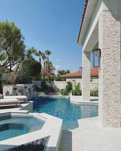 bleached stacked stone pillar with pool
