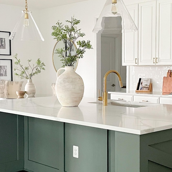 white and soft forest green kitchen with quartz