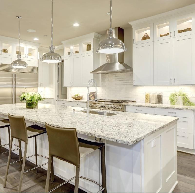 white chef kitchen with granite counter
