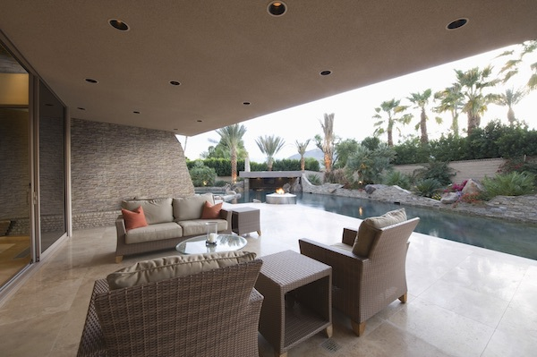 stacked stone panels in soft beige and swimming pool