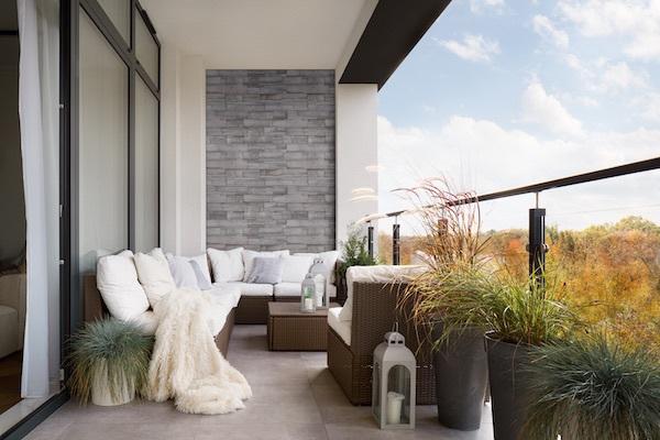 featurd stacked stone wall on balcony patio