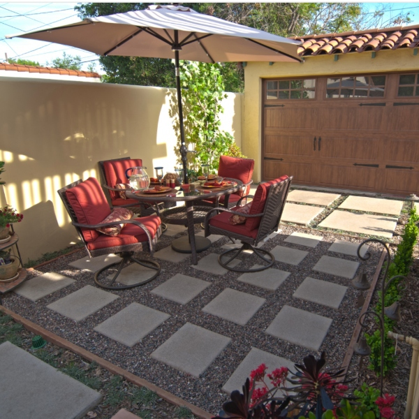 pebble and paver hardcsaping in sunny patio