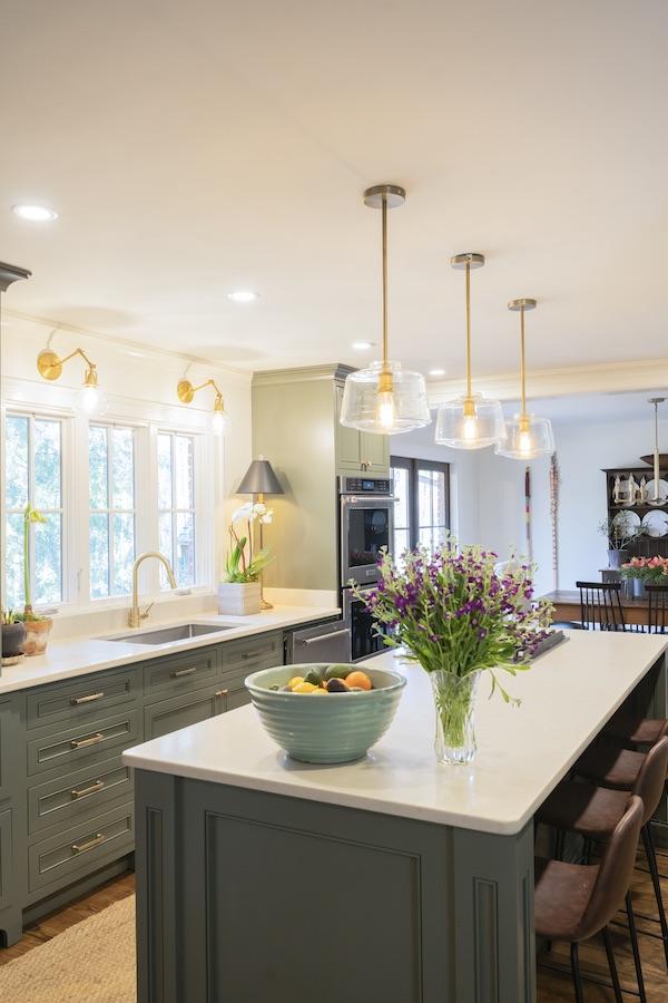 carrara marmi marble look quartz with green cabinets kitchen