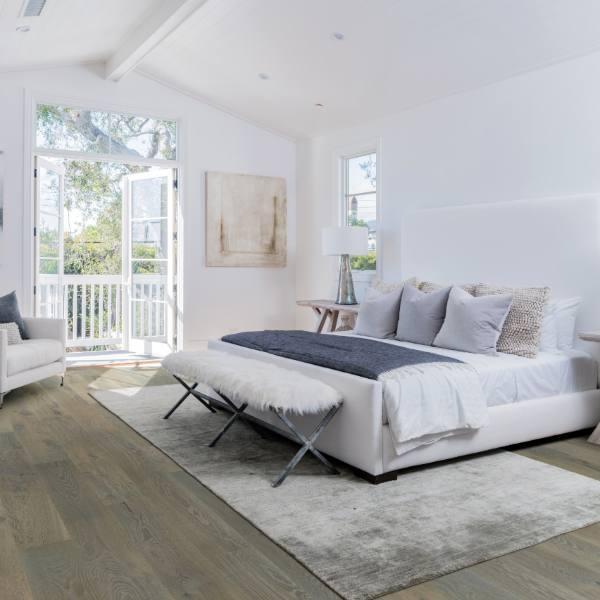 worn wood look lvt tile flooring in white bedroom