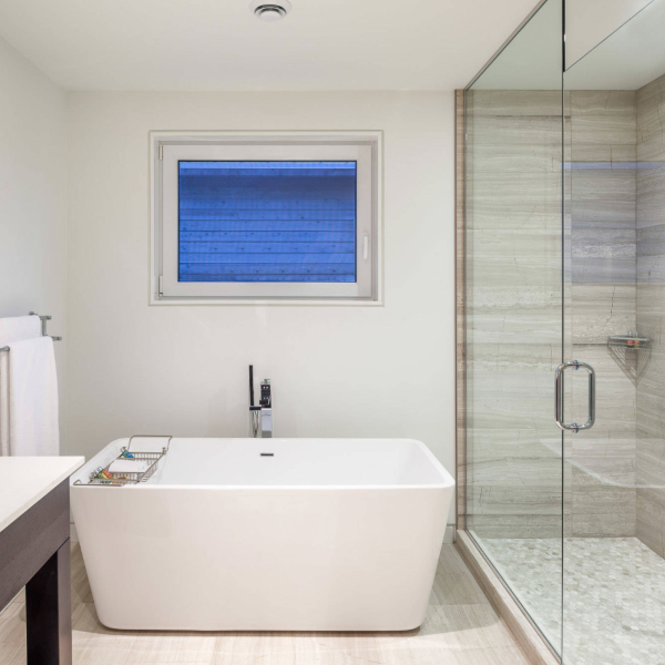 porcelain tile floor and shower in hotel bathroom