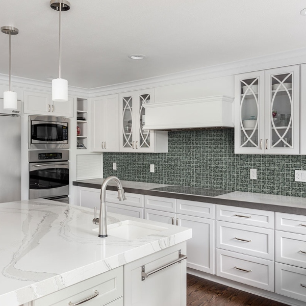 green floral glass tile kitchen backsplash