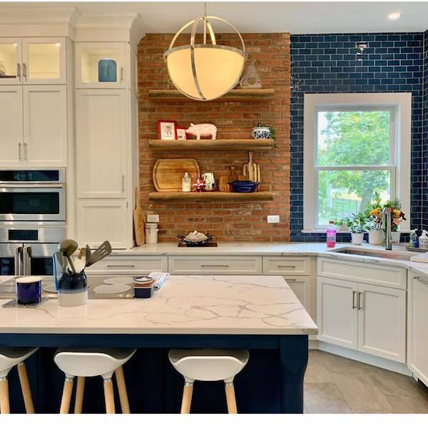 modern country kitchen with quartz counter and blue backsplash