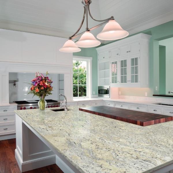 brilliant white windowed cabinets with soft yellow white granite