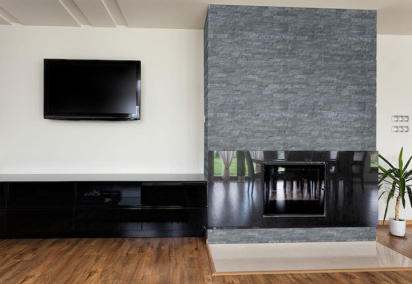 stacked stone paneled fireplace in modern living room