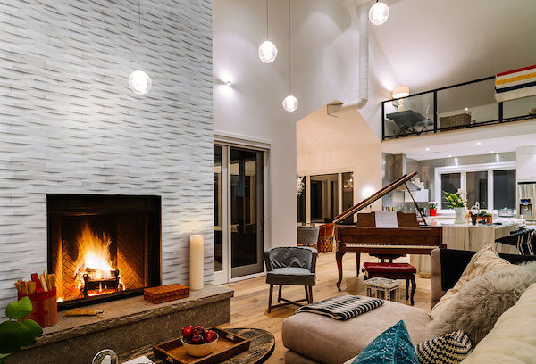3d wave stacked stone fireplace in chic living room
